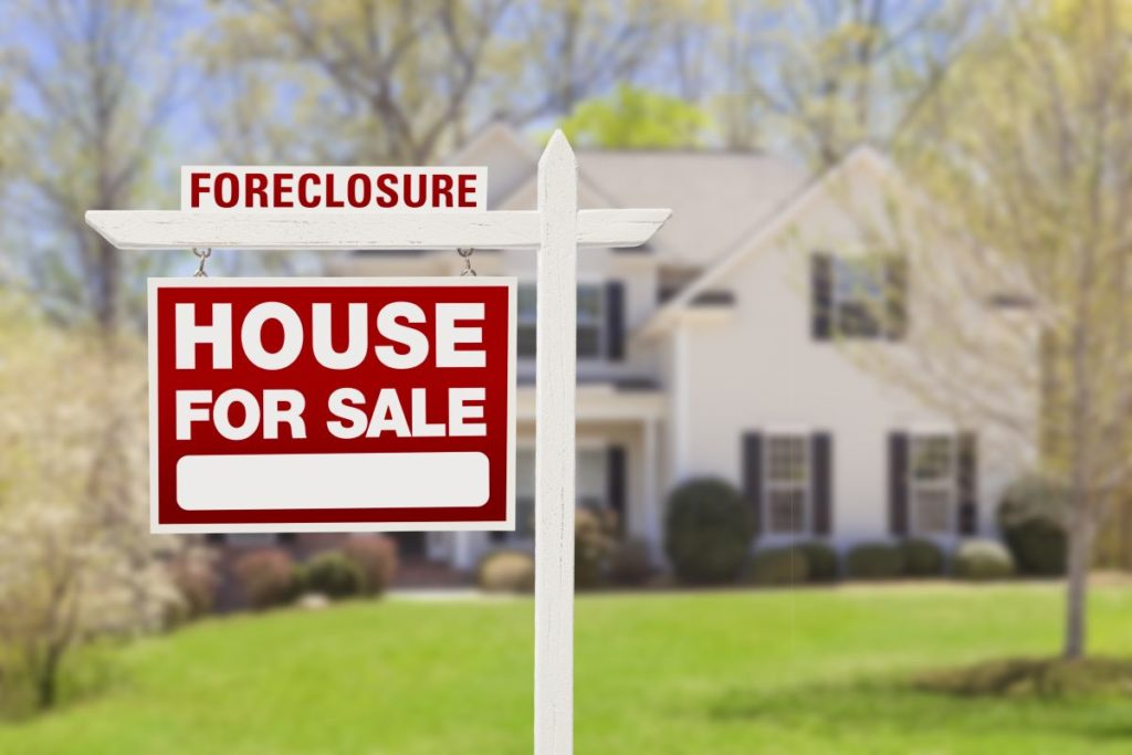 foreclosure house for sale sign