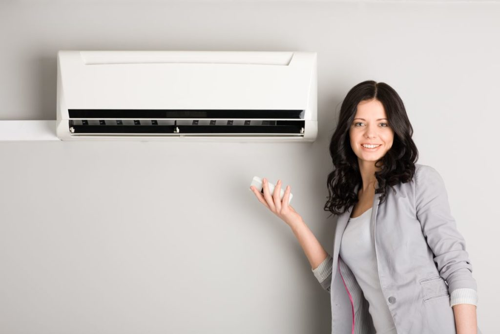 woman air-conditioning unit