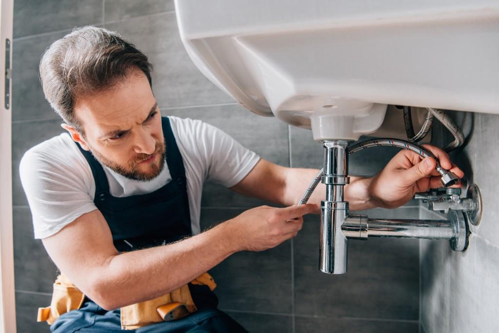 man installing bathroom sink
