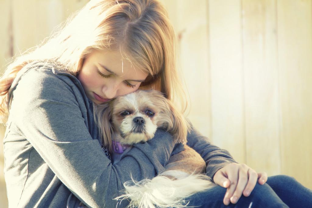 person hugging pet